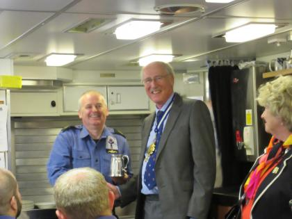The Man of the Boat receives his award from the Master when he visited HMS TALENT in April 2015.